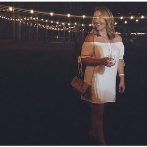 Off the shoulder white mini dress